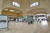LIMOGES, FRANCE - SEPTEMBER 10, 2013: People inside the Limoges-Benedictins Train Station. Built in
