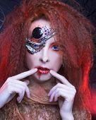 stock photo of woman dragon  - Portrait of young  ginger woman with artistic visage - JPG