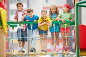 stock photo of youngster  - Happy friends having fun on playground - JPG