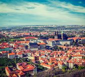 Vintage retro hipster style travel image of aerial view of Hradchany part of Prague: the Saint Vitus