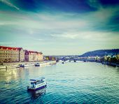 Vintage retro hipster style travel image of tourist boat on Vltava river in Prague, Czech Republic