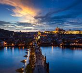 pic of nightfall  - Night aerial view of Prague castle and Charles Bridge over Vltava river in Prague - JPG