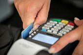 stock photo of receipt  - Debit card swiping on pos terminal - JPG