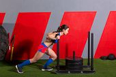 picture of sled  - sled push woman pushing weights workout exercise at gym - JPG