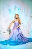 stock photo of snow queen  - Young beauty woman in princess dress on a background of a winter fairy tale - JPG