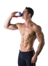 image of blender  - Muscular shirtless male bodybuilder drinking protein shake from blender - JPG