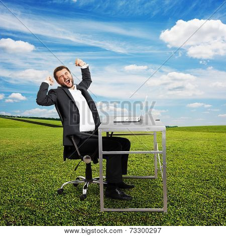 fatigued businessman yawning and stretching oneself. photo at outdoor