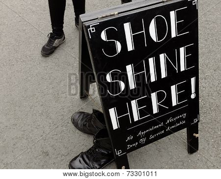 a sign for 'Shoe Shine Here