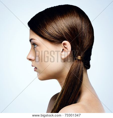 Side view portrait of a beautiful woman with clean face