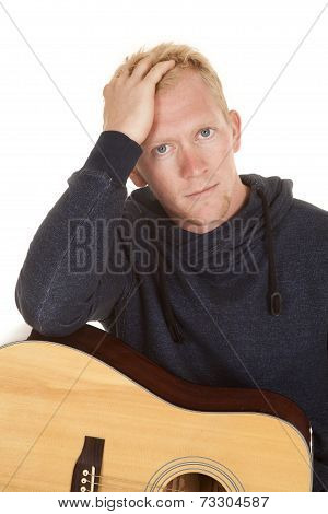 Man In Hoodie With Guitar Close Stressed