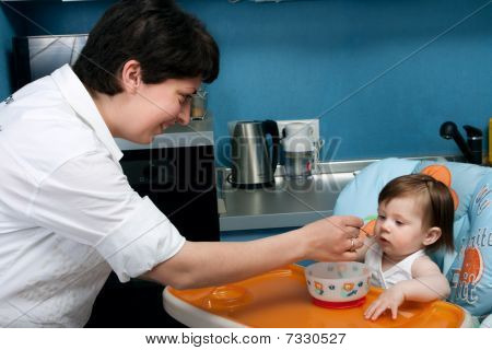 Mother And Baby At The Kitchen