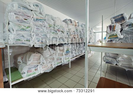 Shelves with clean linen in dry cleaning
