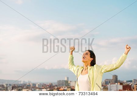 Successful Urban Athlete On Outdoor Exercising Raising Arms