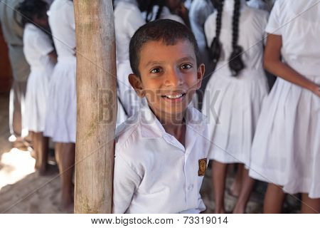 HABARADUWA, SRI LANKA - MARCH 11, 2014: Portrait of school kid at Sea Turtle Farm and Hatchery. The center was started in 1986 and up to now they released more than 500,000 Turtles to ocean