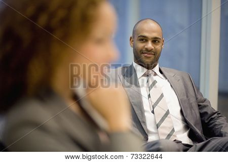 African businessman looking at coworker