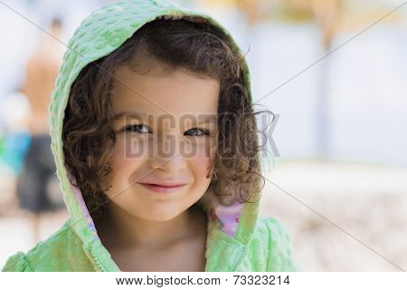 Hispanic girl wearing hooded sweatshirt