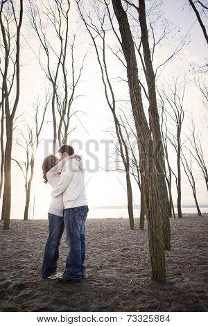 Korean couple kissing on beach