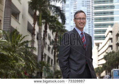 Caucasian businessman with hands in pockets