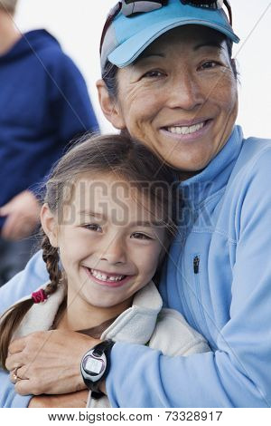 Japanese mother and daughter hugging