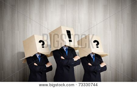 Business people with carton boxes on head