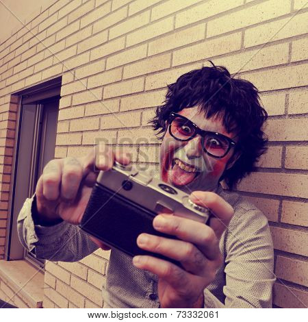 a scary hipster zombie taking a selfie of himself with a vintage camera, with a retro effect