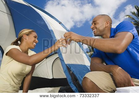 African couple setting up tent