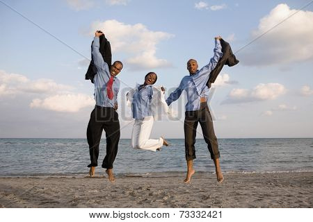 African businesspeople cheering at beach