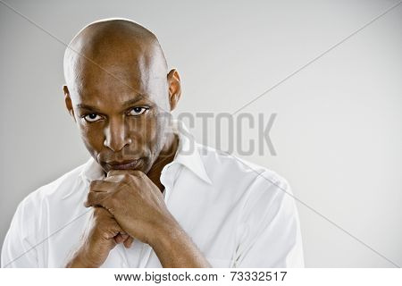 African man resting chin on hands