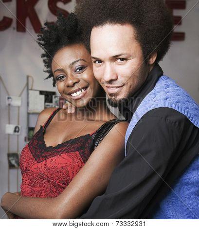 Multi-ethnic man and woman hugging