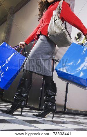 Hispanic woman carrying shopping bags