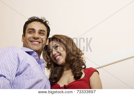 Low angle view of Multi-ethnic couple