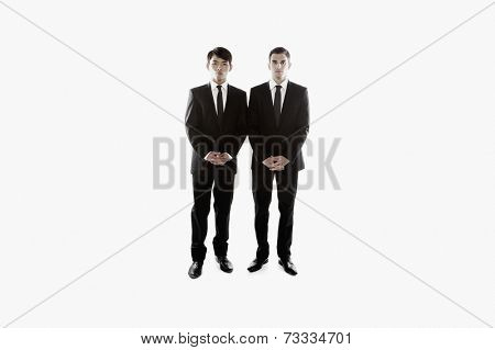 Multi-ethnic businessmen standing side by side