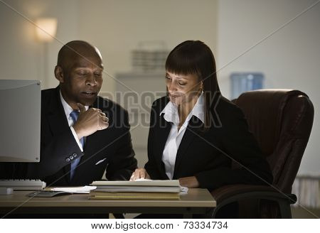 African businesspeople looking at paperwork