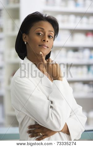 African female pharmacist with finger on chin