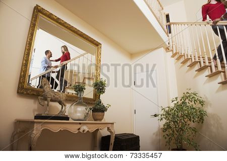 Reflection of Multi-ethnic couple on stairs