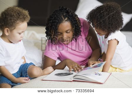 African mother reading to children