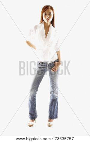 Asian woman with thumb in pocket