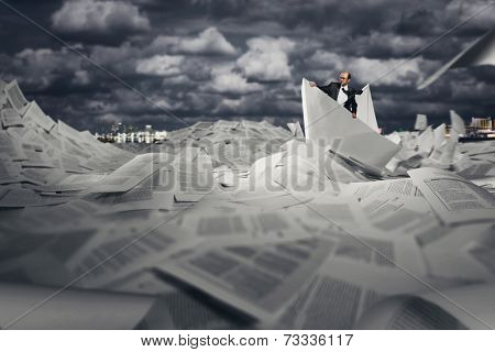 Successful businessman sailing on paper boat