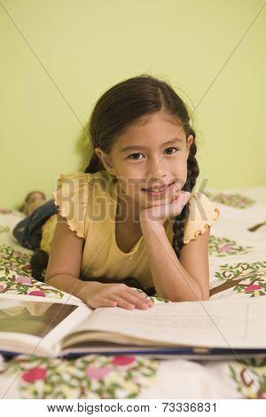 Pacific Islander girl reading book