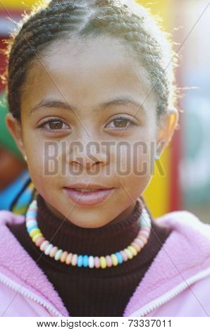 Mixed Race girl with cornrows