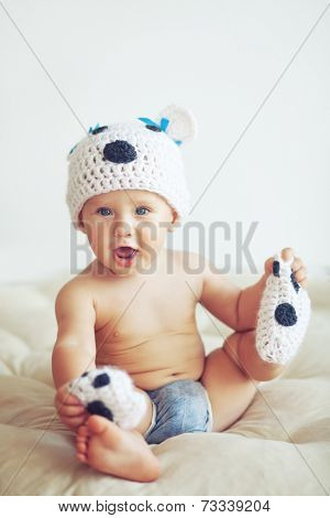 Portrait of a cute 1 year old baby dressed in a bear hat