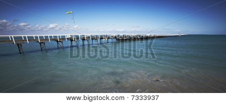 long pier stretching into the sea