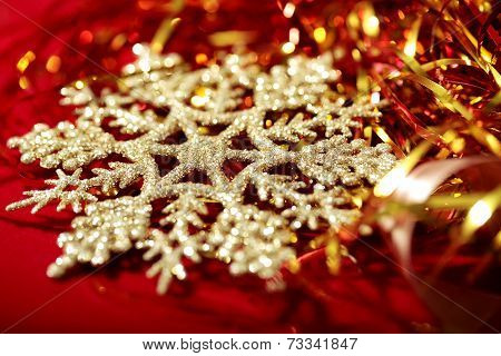 Golden snowflake and tinsel christmas background