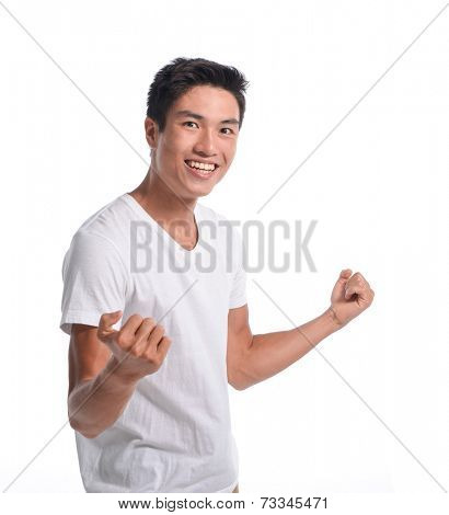 Portrait Of Smiling Man With The Fists Up Against A White Background