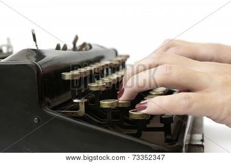 Close Up Of Woman Typing On Old Typewriter