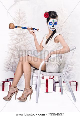 Day Of The Dead Girl With Tobacco Pipe Over Christmas Background