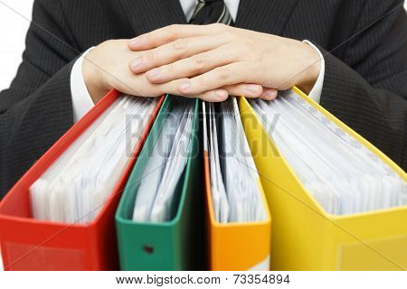 Midsection Of Businessman With Binders At Office