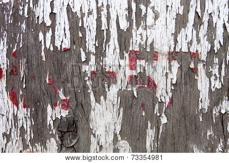 Old Wooden Surface With The Remains Of Cracked Oil-paint