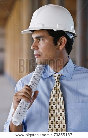 Hispanic businessman wearing hard hat