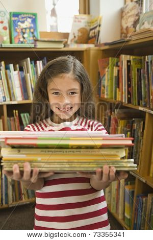 Pacific Islander girl holding library books
